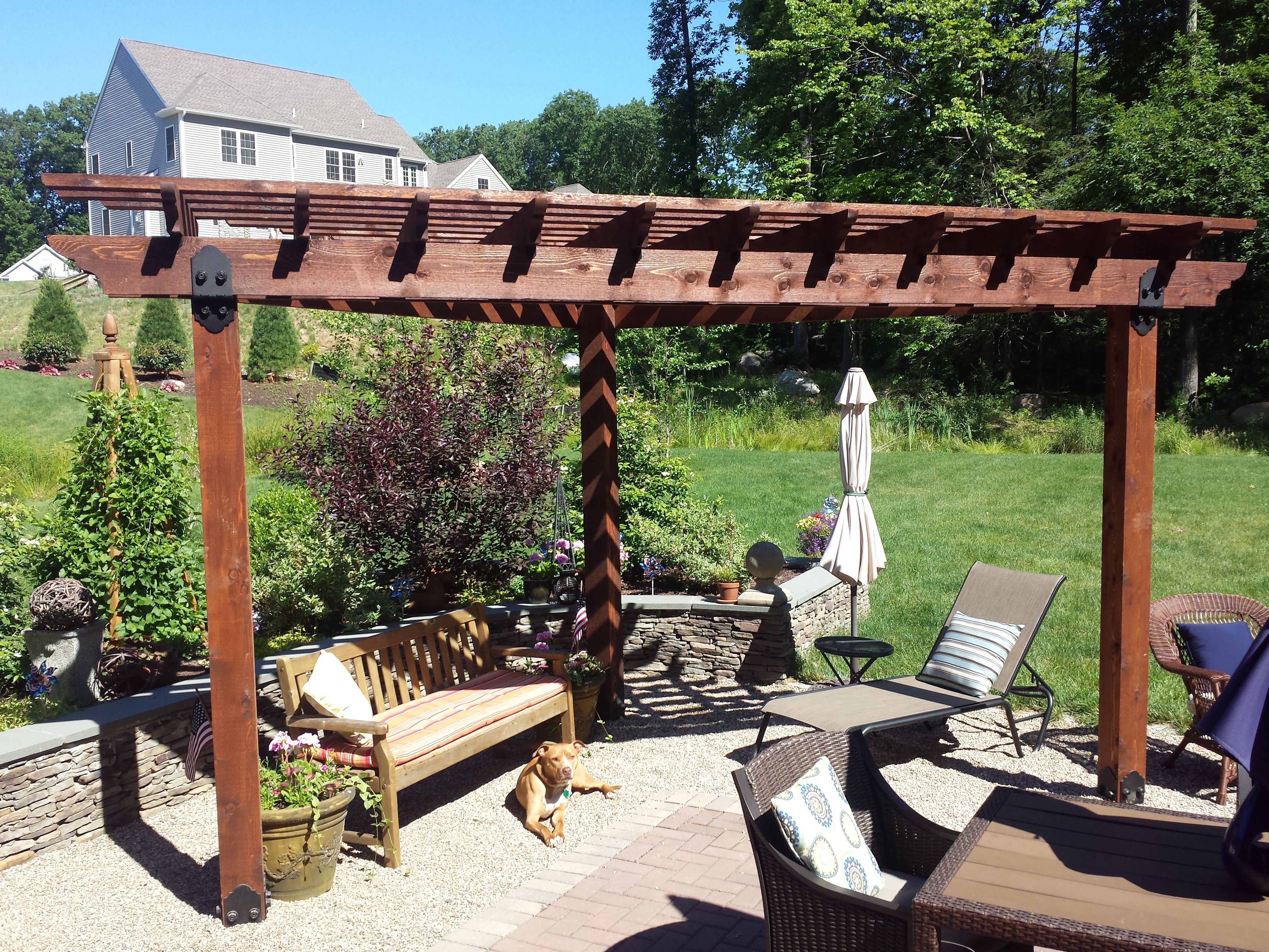 Pergola built using owt hardware provides the needed shade for How to build a corner pergola