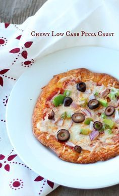This low carb pizza crust is chewy and bready with a crispy crust. It's got just 1.4 net carbs per generous serving. Add your own toppings for low-carb pizza perfection! from Lowcarb-ology.com