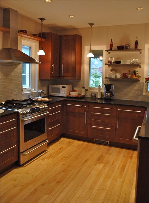 looooove the cherry wood cabinets and the long handles and ...