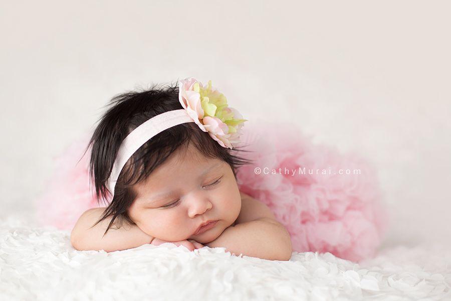 6 weeks old baby newborn baby girl wearing a pink pettiskirt petti skirt pink headband chin on the wrists pose pink cathy murai photography newborn