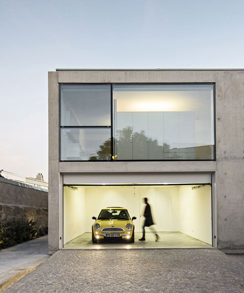 this sleek concrete home by joão vieira de campos doesn't have a door is part of Concrete house - architect joão vieira de campos designed this concrete single family home in the serralves region of portugal with a unique feature