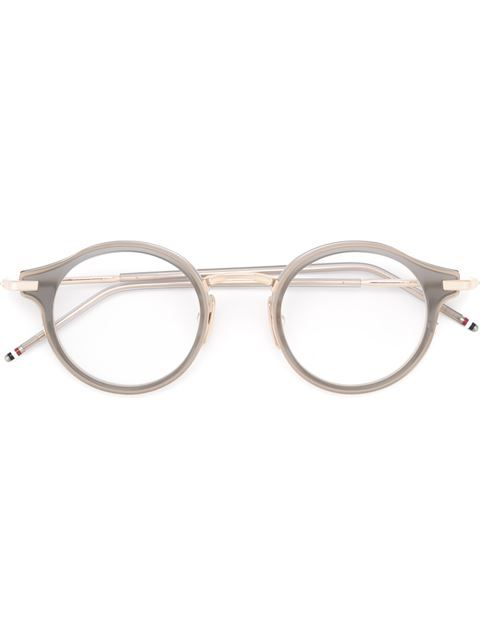 e18038fc9e7 Shop Thom Browne round frame glasses in O' from the world's best  independent boutiques at farfetch.com. Shop 400 boutiques at one address.