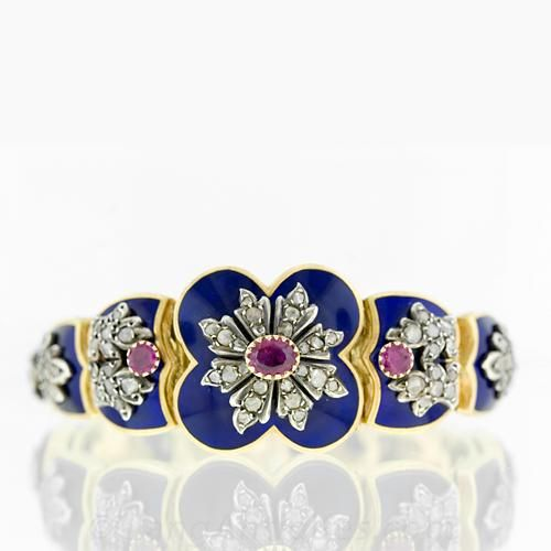 Victorian Cobalt Blue Enamel & Ruby Plaque Bracelet -- This 18 karat yellow gold Victorian beauty in the French style is constructed of five different escutcheon shaped plaques (plus the center plaque) and each has a varying rose cut diamond and silver overlay. Three pinkish-red Burmese rubies contrast with the deep, rich cobalt blue enameling.