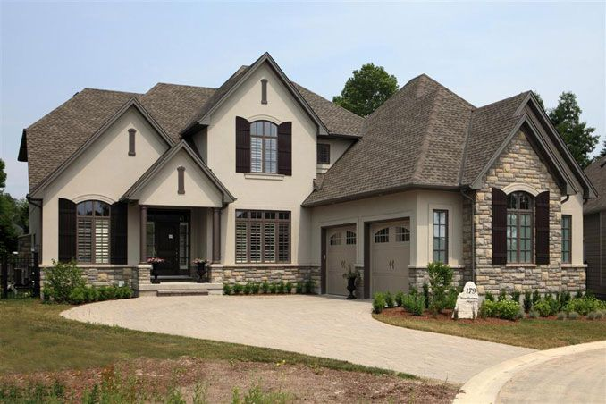 rock stucco exterior home | Bridlewood Homes - I'm so in love with this