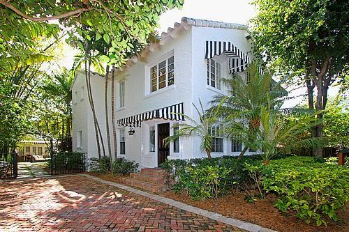 White Spanish With Black And White Awnings Herringbone Pavers Spanish Bungalow Spanish Style Homes Spanish House