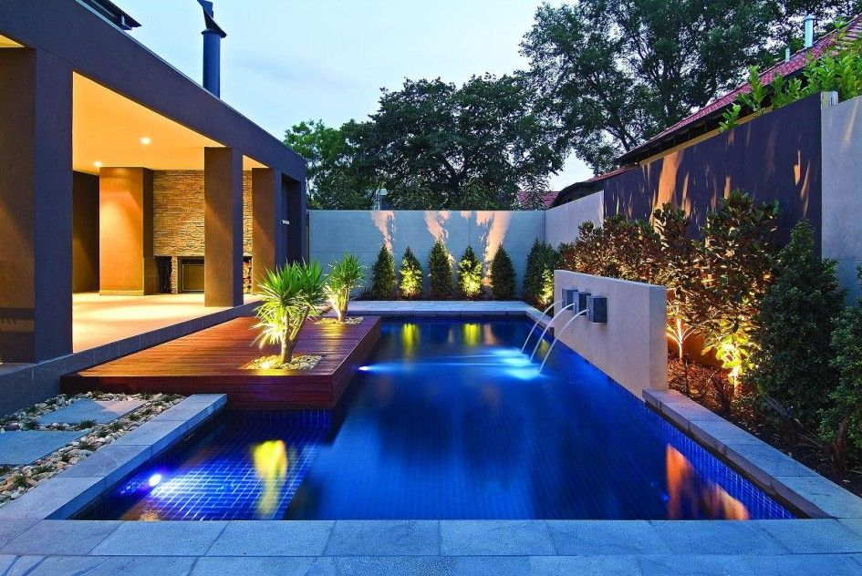 Pools with fountains gripping dark blue pool tiles with for Modern backyard ideas