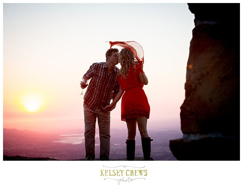 Dramatic Sunset Shot, With Flying Red Scarf. Santa Barbara Engagement and Wedding Photographer, Kelsey Crews.