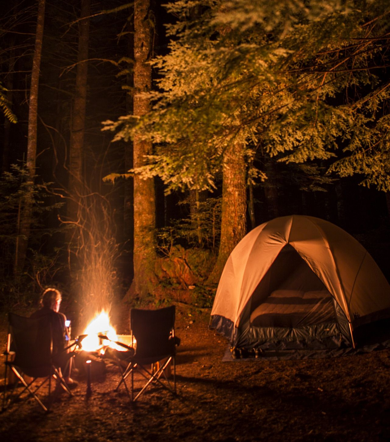 Camping in the woods with a fire
