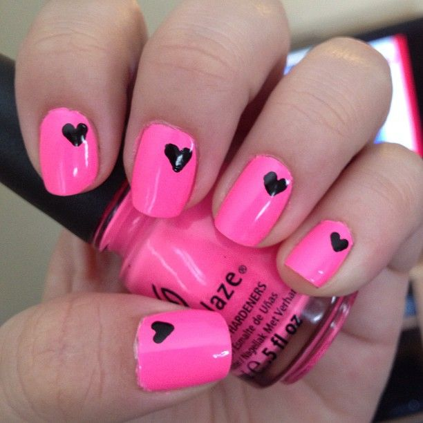 too cute! Paint your nails with a neon color and with a black sharpie draw a heart on each nail. Cover with clear coat and let them dry:)