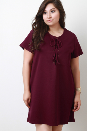 Cocktail Lace Up T-Shirt Shift Dress. Description This  plus size  shift dress is t-shirt silhouette with its short sleeves and a scooped neckline. Its elegant touch is featured by the criss-crossing straps lace up look. Accessories sold separately. 65% Rayon. 30% Nylon. 5% Spandex.  Measurement   Size Bust Waist Hip Length Sleeve   1X 22.5 23 24 35.5 7.5   2X 23.5 24 25.25 36 7.75   3X 24.5 25 26.5 36.5 8