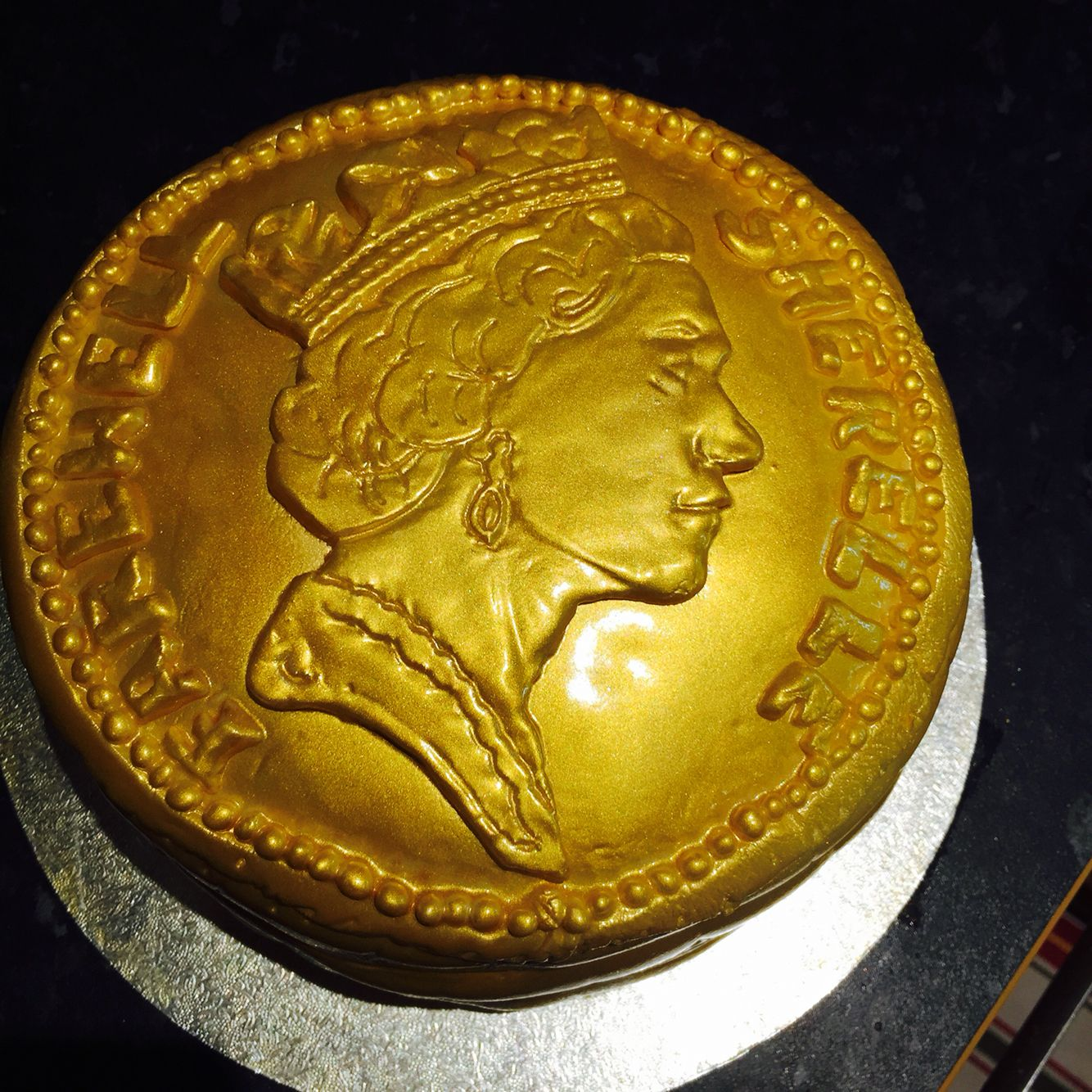 Pound coin cake with images fondant cakes