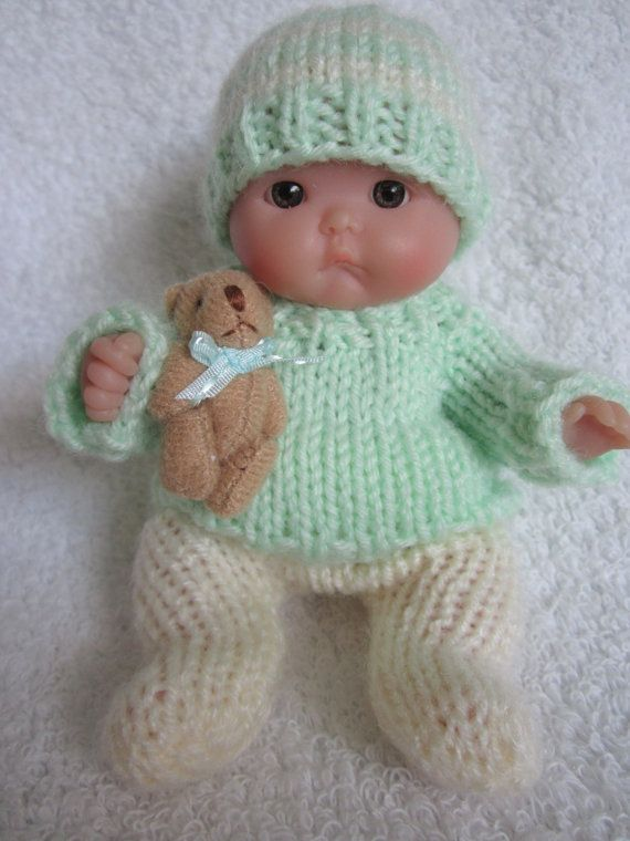 cute mint green sweater and tiny toy bear