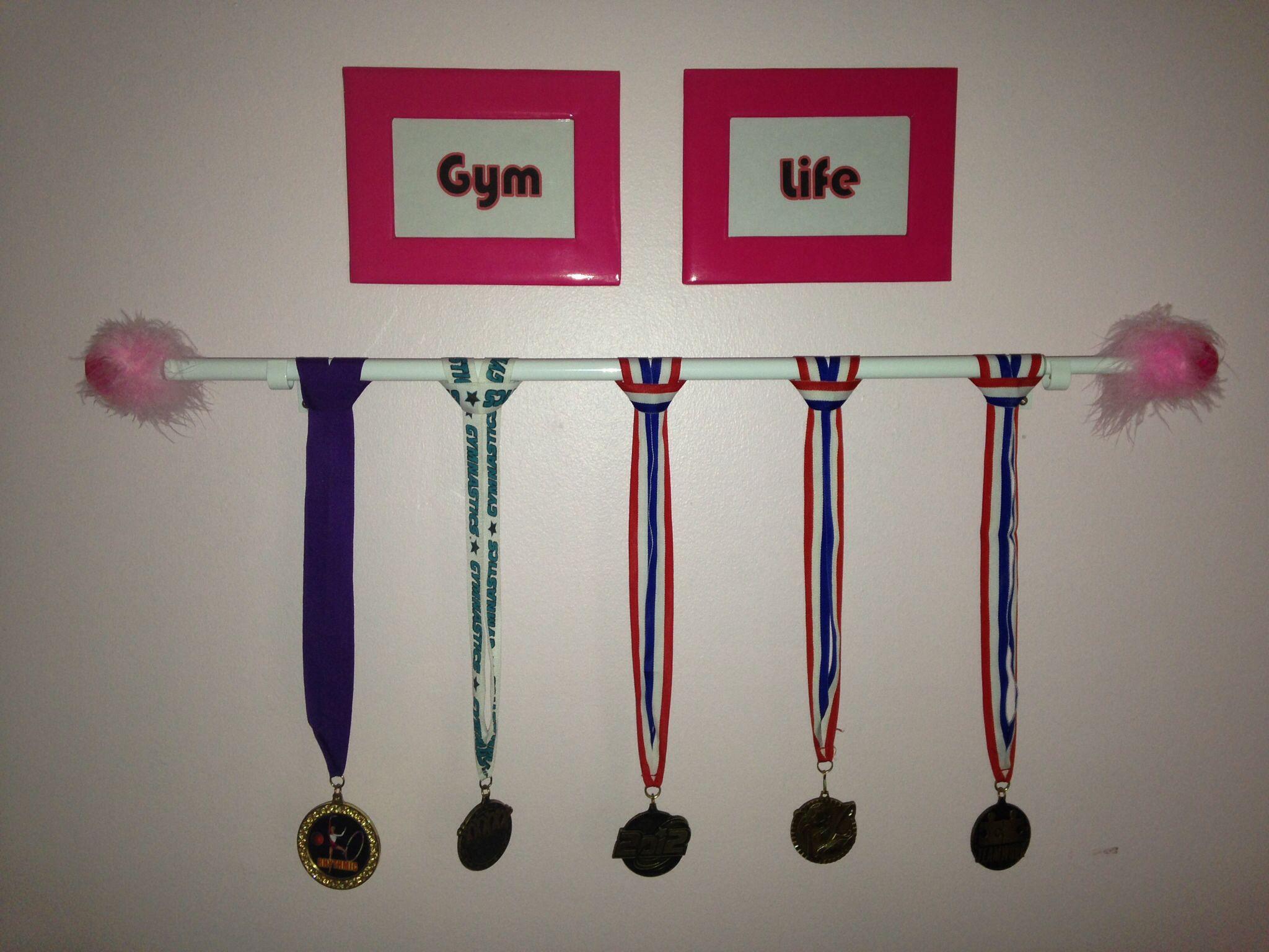 Use a curtain rod for an easy and cheap medal award for Curtain display ideas