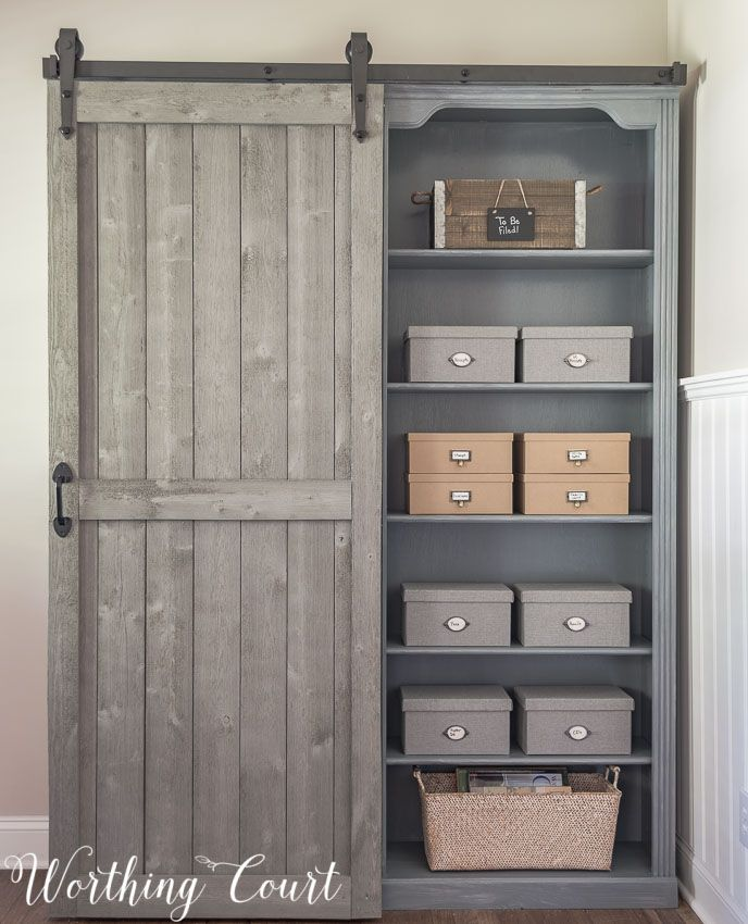 Bookcase makeover traditional cherry to farmhouse fab for Farmhouse sliding door