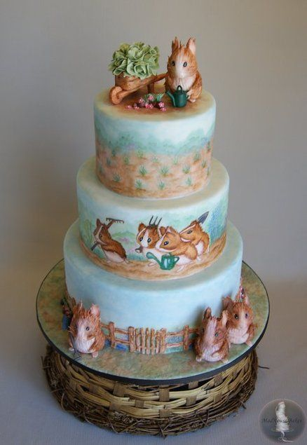 Beatrix Potter Guinea Pig Cake  ~  All of the guinea pigs are sculpted from gum paste and hand painted, as well as the wheel barrow, watering can, veggies, fence, flowers and greenery.