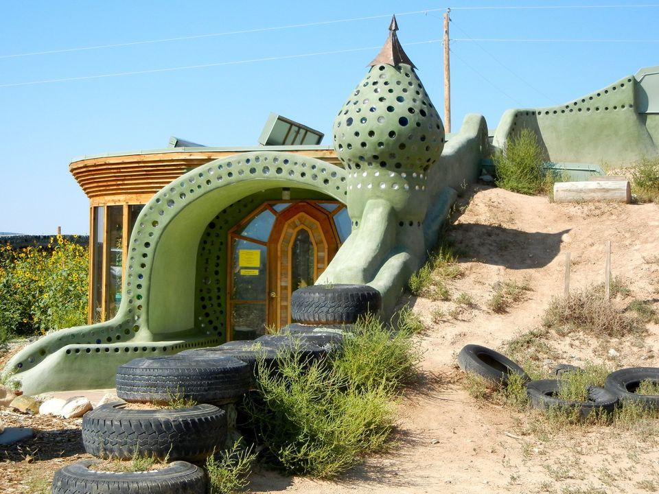 I never knew tires made good walls wacky houses for Home builders in new mexico