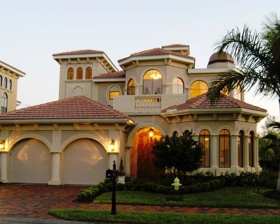 gorgeous luxury home exterior for custom home mediterranean house exterior design white garage door portofino - Luxury Home Exterior Designs