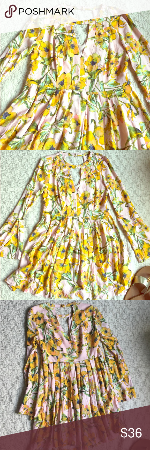 Free People Tegan Floral Baby Doll Dress Beautiful floral design, key hole cut outs at neckline and in back, functional pockets, side zipper closure. This is a perfect dress to wear with wedges now and booties in the fall. Looks like store sensor created a little pinhole sized hole on material. Barely noticeable but I included a photo for reference. NWT Size 6 Free People Dresses Mini