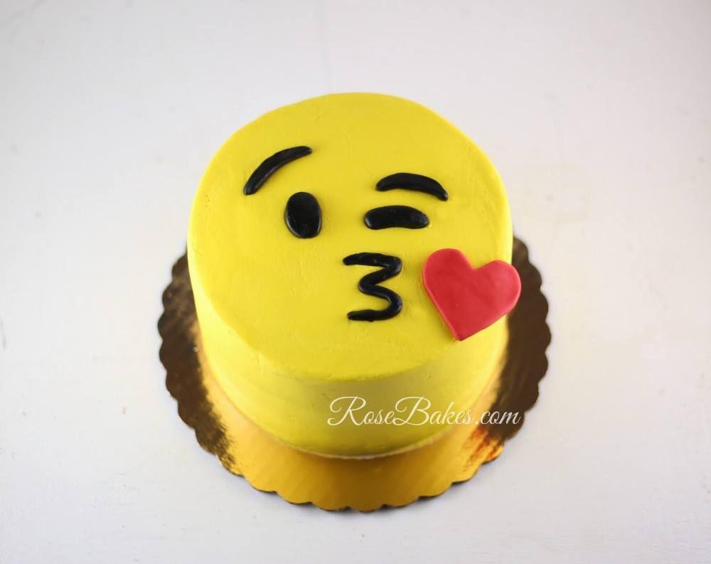 Face throwing a kiss emoji cake