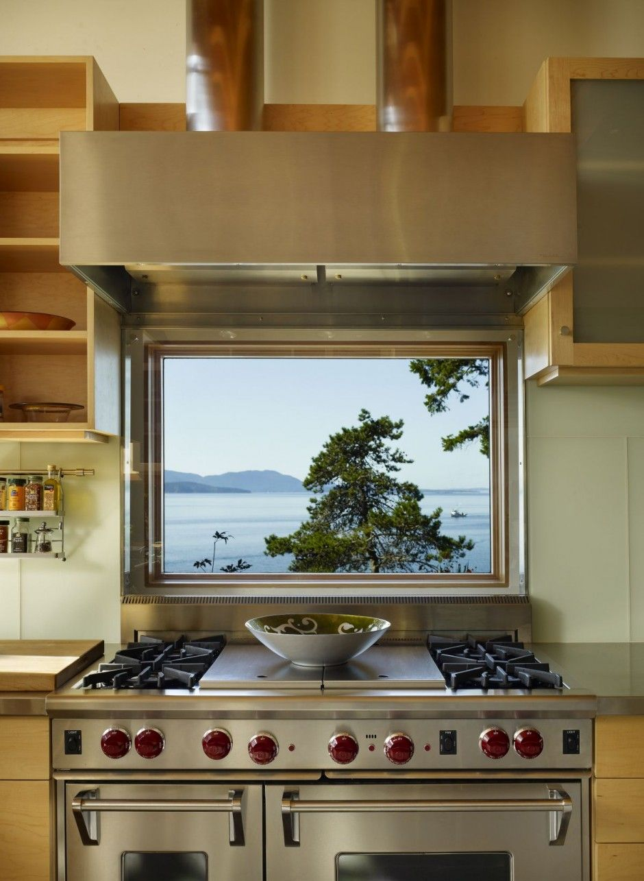 love the way this window opens up the stove area. what a lovely