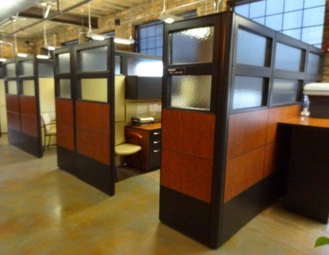 Laminate panel and glass cubicles in open brick office building by connecting elements