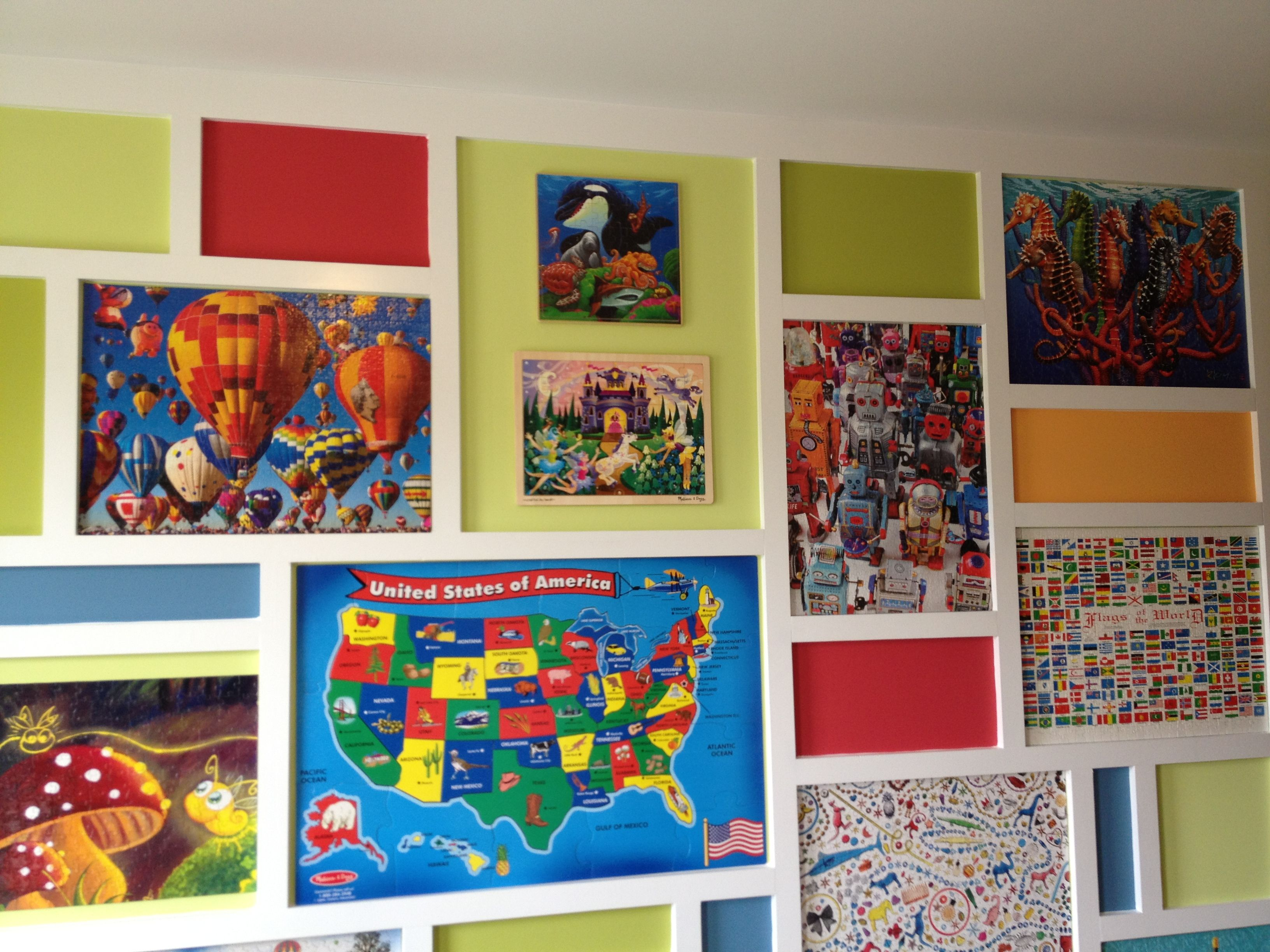 Puzzle Wall In Play Room Paint Wall A Bright Color Then Hang Puzzles And Create Frames Around Them Puzzle Crafts Puzzle Frame Art Gallery Wall