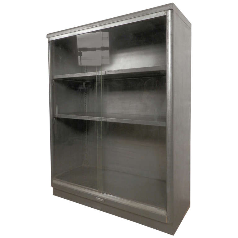 Industrial Metal Cabinet w/ Sliding Glass   From a unique collection of antique and modern cabinets at http://www.1stdibs.com/furniture/storage-case-pieces/cabinets/