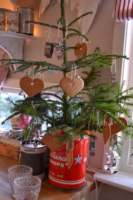 Christmas Tree In...a red tin can...with scented cinnamon heart ornaments.