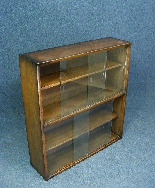 A wonderful vintage oak glass front bookcase display cabinet Original