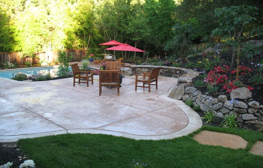 Backyard Stamped Concrete Patterns Design Ideas With Ashlar Around Pool And Wood Patio