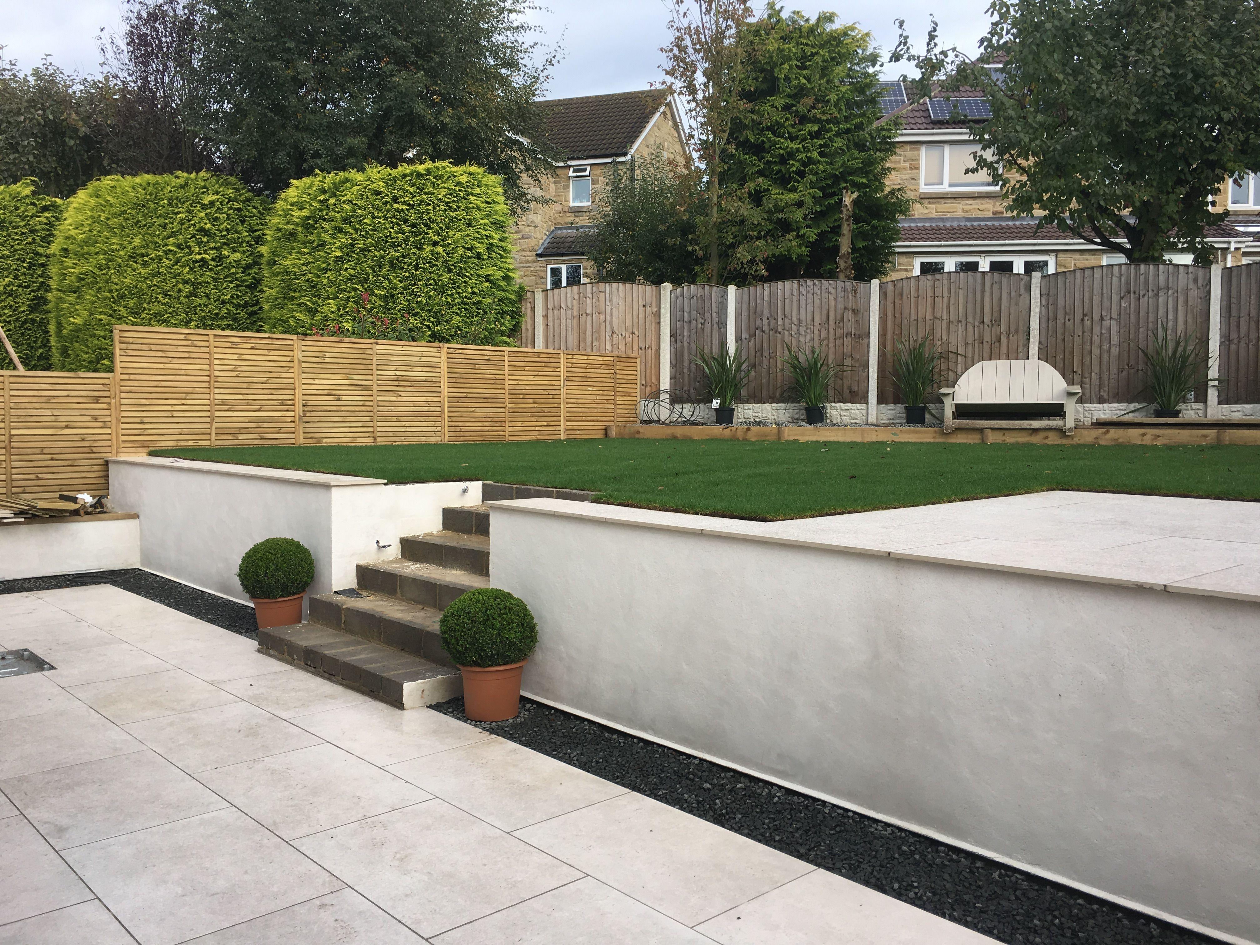 Modern garden split level garden rendered walls cream for Split level patio