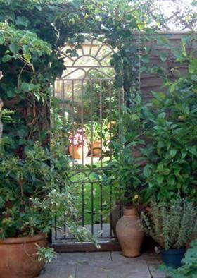 Marvelous Wrought Iron Glass Mirror Gate To Bring Depth To Garden   Acrylic Mirrors  Are Lighter And Resist Shattering
