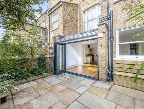 side return by VC Design in Brook Green part solid, part Glazed roof with sliding folding aluminium doors. Developer client sold for healthy profit after converting from 1bed to 2 because of the extension
