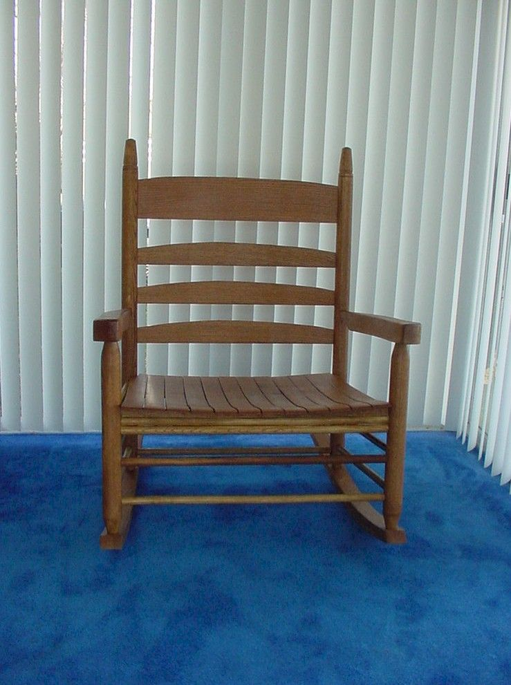 A Super Wide Oversized Rocking Chair Next To The Fireplace Rocking Chair Wooden Rocking Chairs Chair