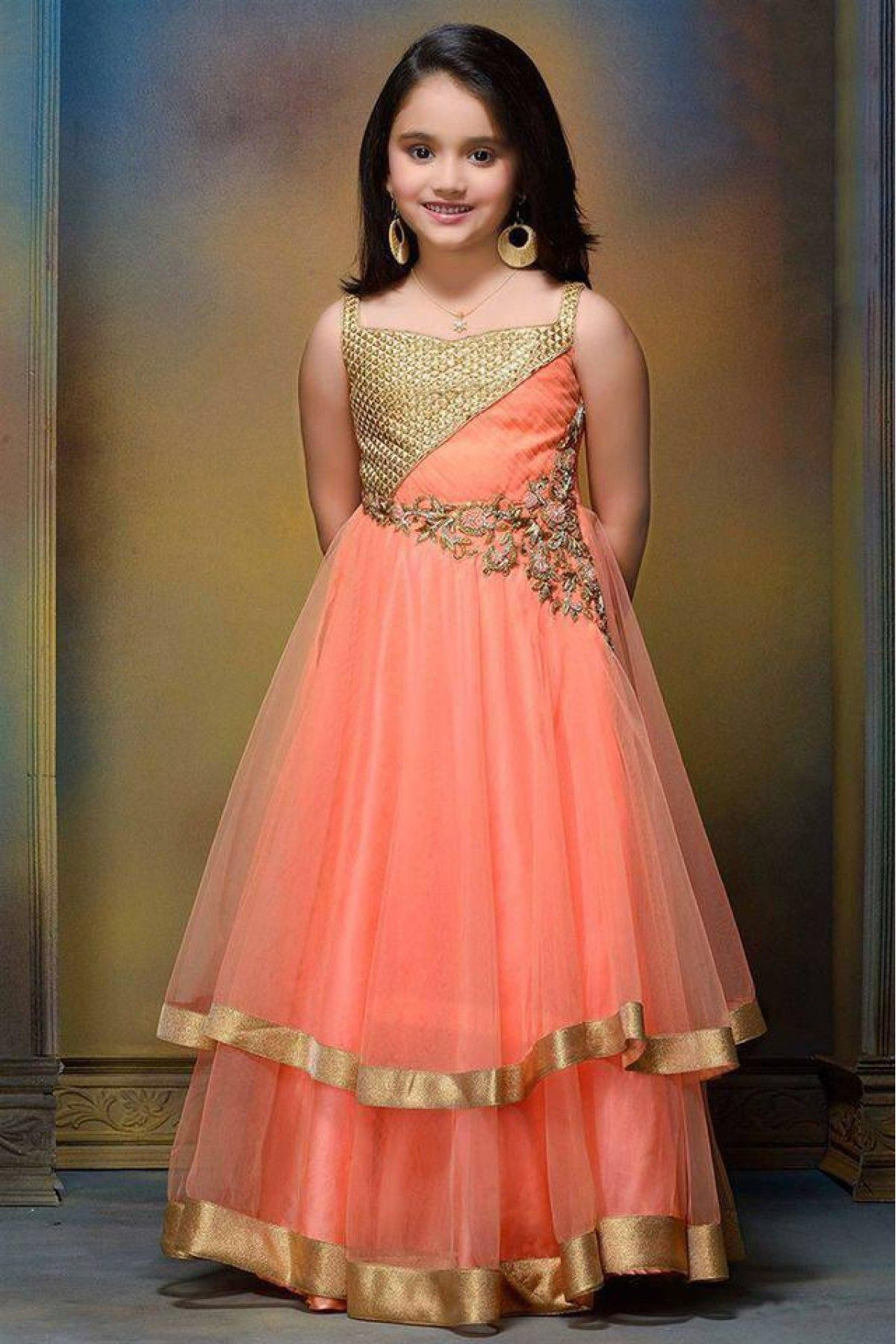 Net and silk party wear gown in orange colour indian dress