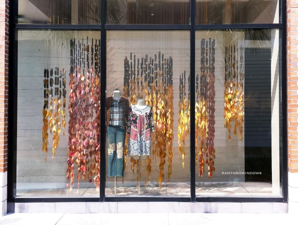 Anthropologie turning of the leaves fall window displays for Anthropologie store decoration ideas