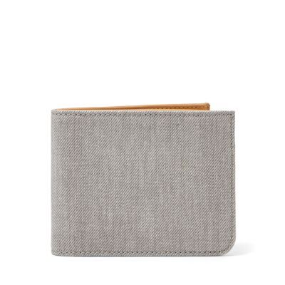 The simple Nicolai wallet has a spacious cash compartment as well as room for three cards on each side of its slim fold-out design.