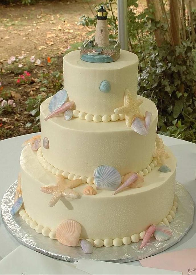 Seashell Wedding Cake With Lighthouse Topper
