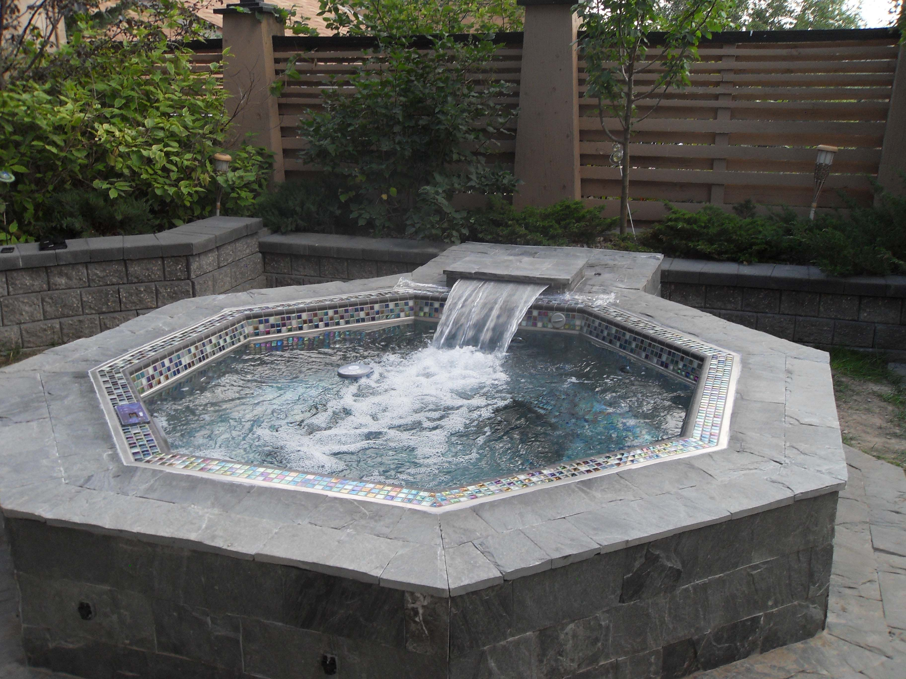 Classic hanover stainless steel hot tub with custom tile for Waterfall tile design