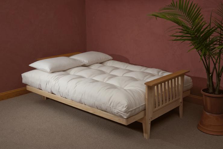 Adorable Futon Mattresses With 2 White Pillows Futon Bed