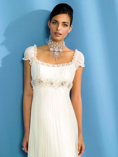 short sleeve wedding dress! love the big necklace and the hair! So ...