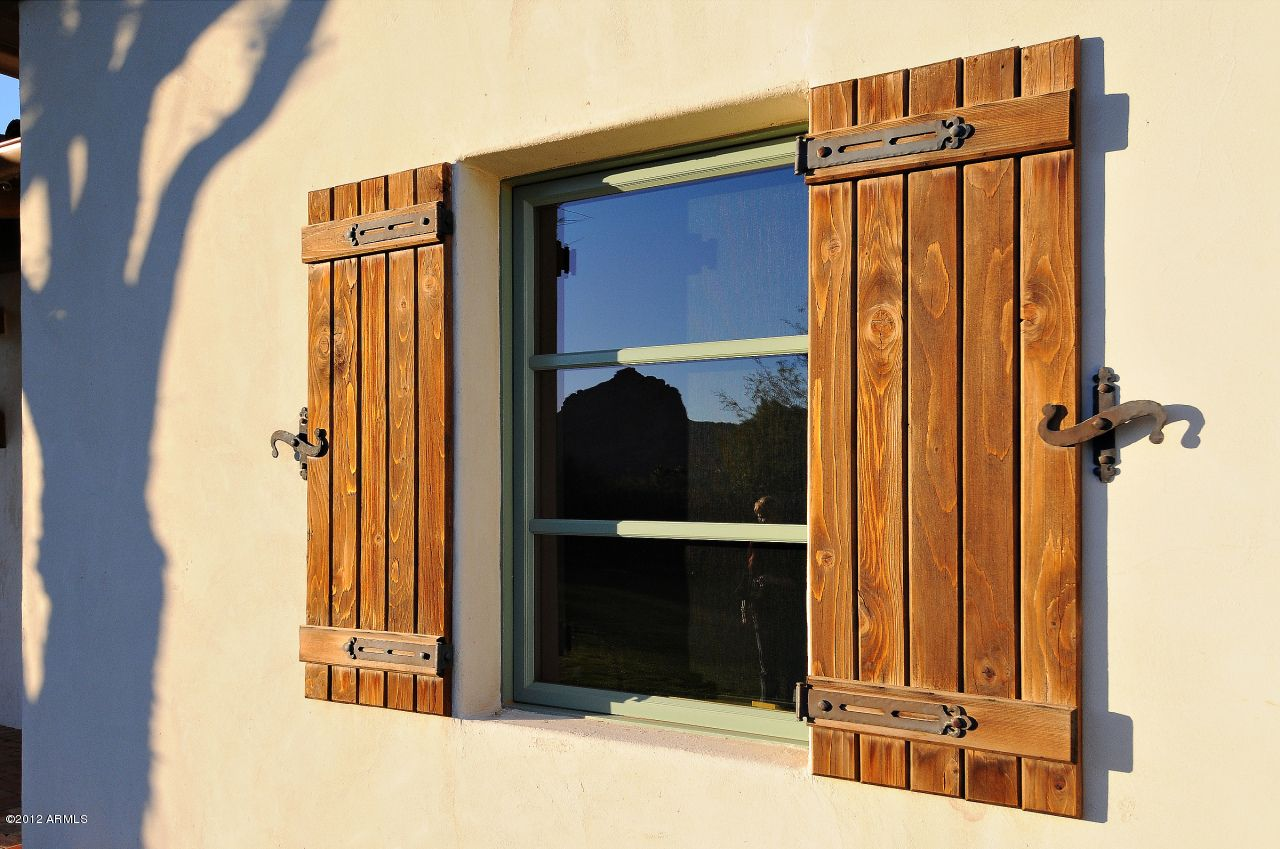 Find this hardware and make these shutters santa for Spanish style window shutters