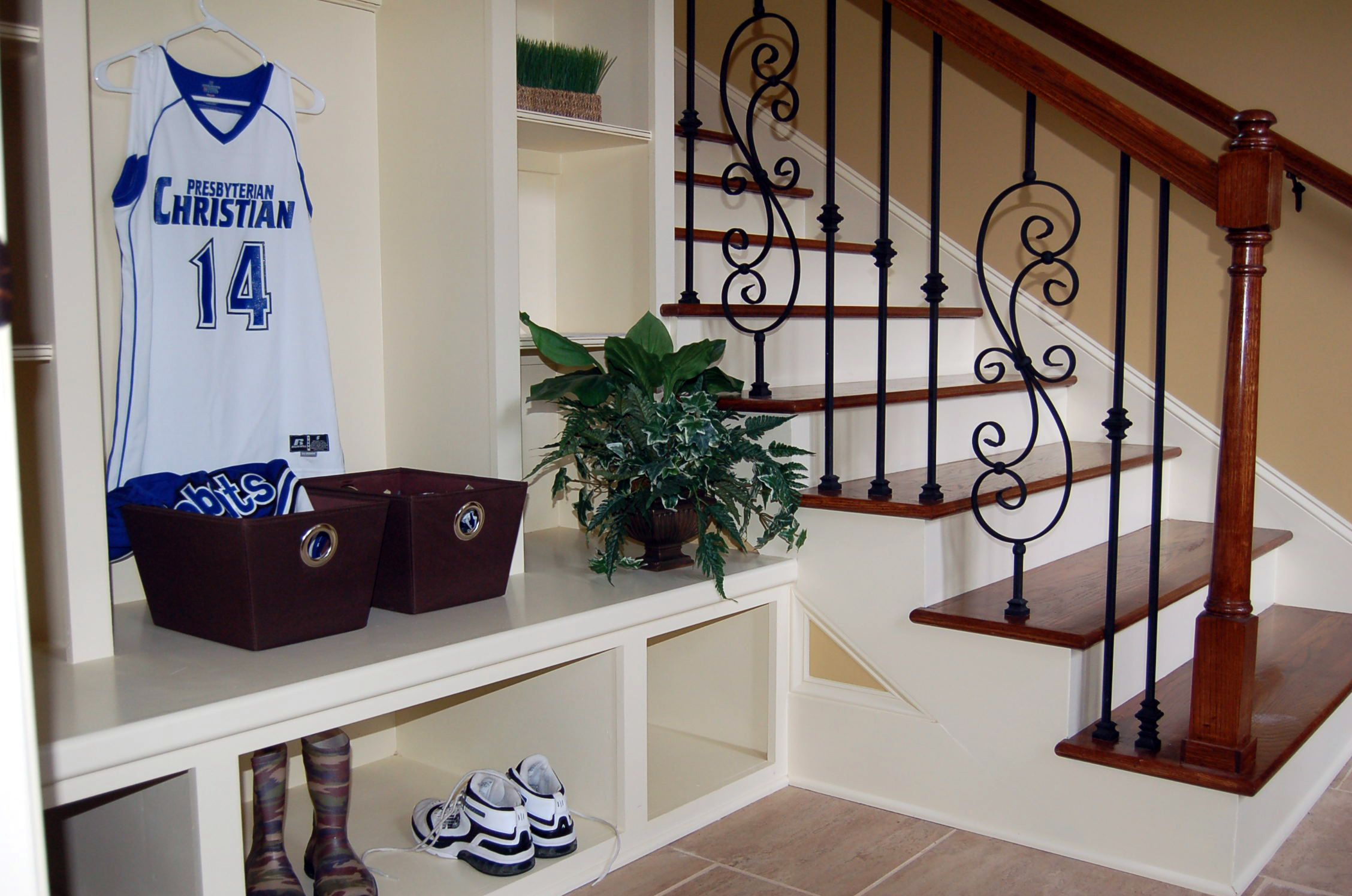Certitied Green Home shows Garage Entry Cubbies and Foot Lockers prior to Stairs leading to Kid's Bedrooms. By AAA Homes of MS, LLC.
