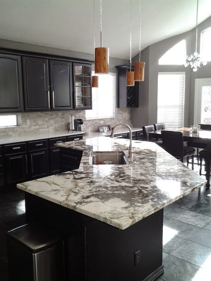 We Lowered The Bar Height Portion Of This Island Down So It S All Counter Height This Not Only Opens The K Custom Kitchen Island Kitchen Remodel Condo Living