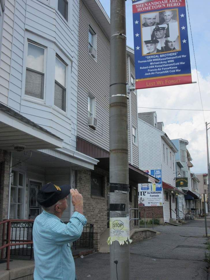 My Grandfather's hometown put up banners throughout town honoring local military veterans. This is him seeing the banner dedicated to himself and his 4 late brothers.