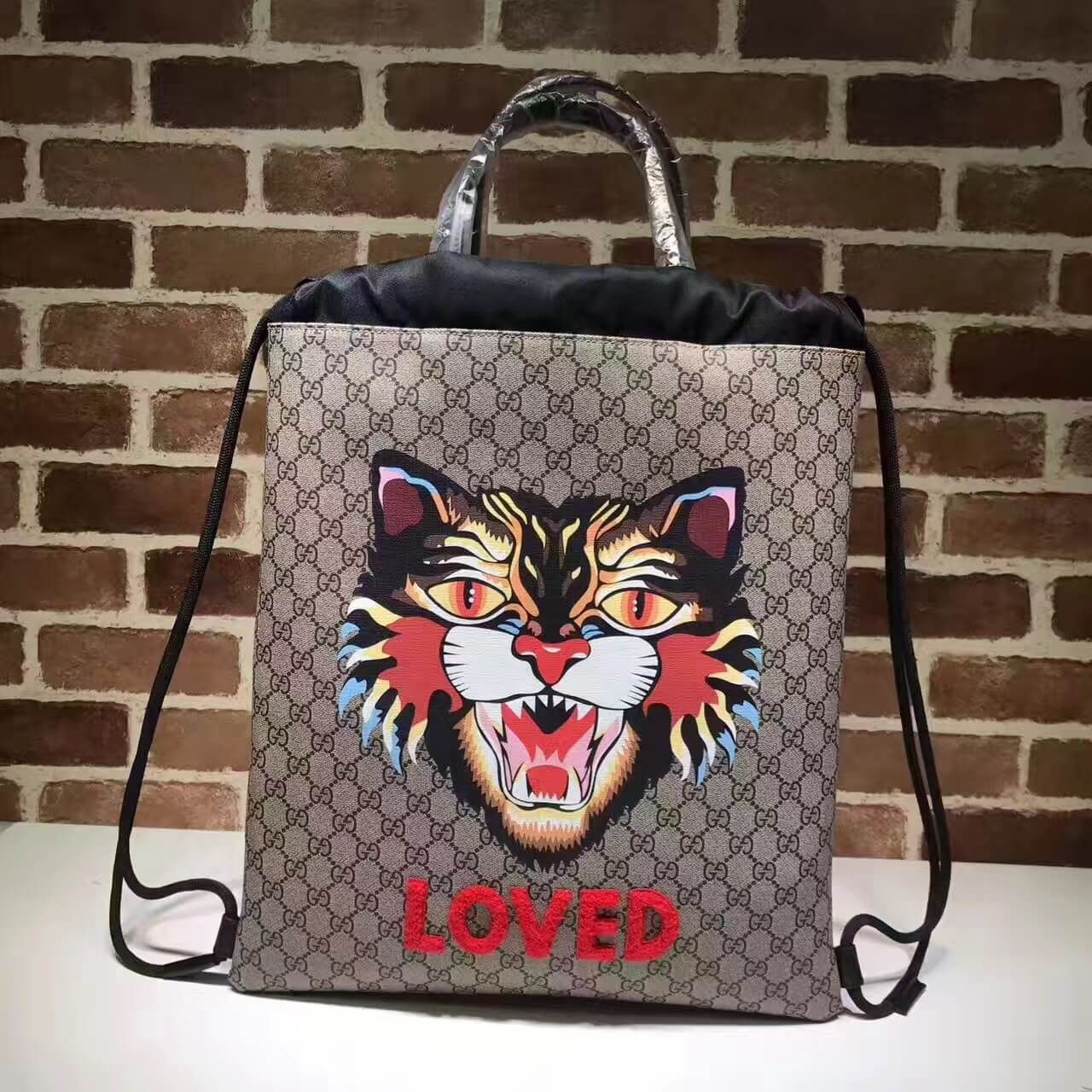 203b498def8 Gucci Angry Cat Print Soft GG Supreme Drawstring Backpack 473872 2017