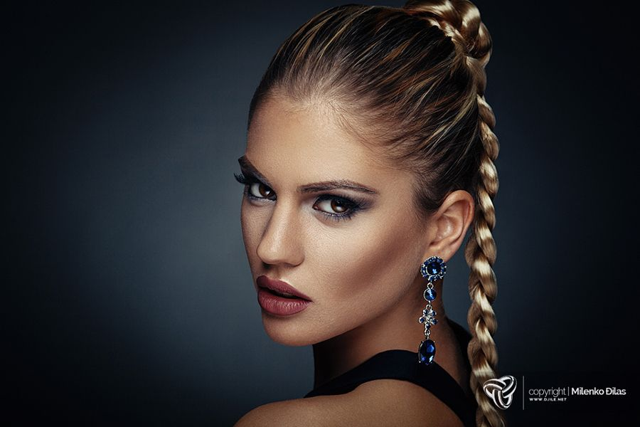 Beauty portrait of a young woman with braid hairstyle by