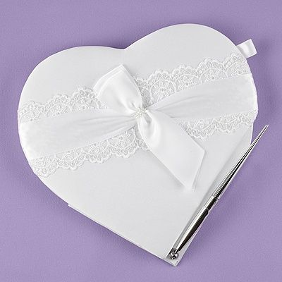 """Lace Allure Heart Guest Book and Pen Set - White satin, heart-shaped guest book with lace band, white satin bow and faux pearl accents. Silver-tone pen writes in black ink. Records 500 signatures.    Guest Books provide documentation of the guests who've attended your special event. This is useful when writing thank-you notes. They also serve as a reminder of all the wonderful, caring friends and family you have!    Dimensions: 10"""" x 9 3/4""""  Price Includes: Blank heart guest book and pen set"""