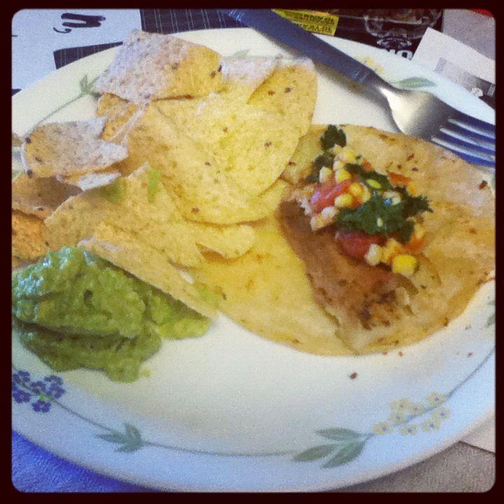 Sauteed tilapia corn taco with homemade salsa and guac. Perfection.