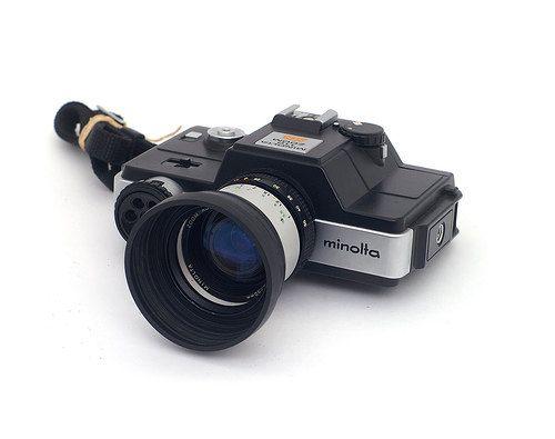 Minolta 110 Slr Zoom Film Camera With Auto 25 Flash And Manuals